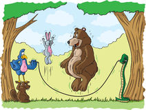 Skipping rope. Animals playing in the forest Royalty Free Stock Photos