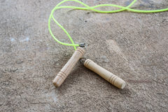 Skipping rope for an exercise on cement floor. The skipping rope for an exercise on cement floor Stock Photos
