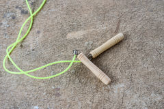 Skipping rope for an exercise on cement floor. The skipping rope for an exercise on cement floor Stock Image