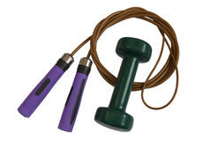 Skipping rope and green dumbbell Stock Images