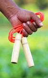 Skipping rope in hand Royalty Free Stock Images