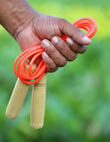 Skipping rope in hand Royalty Free Stock Image