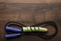 Skipping rope and measuring tape Stock Photo