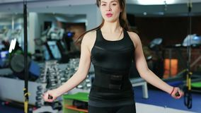Skipping woman training at the gym, working out is healthy fitness body kickboxer, Female Jumping Rope in Gym stock video