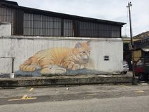 Skippy. Street art of an orange cat on a large white wall Royalty Free Stock Images