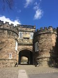 Skipton castle, lancashire- entrance. A historical landmark, on a summers day as we approach the gate. cannons are visible either side Stock Photos