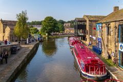 Skipton, North Yorkshire, UK. Skipton, North Yorkshire, England, UK - September 14, 2016: Narrowboats on the shore of the Leeds and Liverpool Canal with people Stock Image