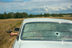 Skirmish, chase and shooting on car Royalty Free Stock Photography