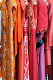Skirt of female. Skirt or fashion for female, in red and orange color, is hanging for showing and saling Royalty Free Stock Image