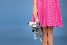 Skirt girl with stuffed animal Stock Images