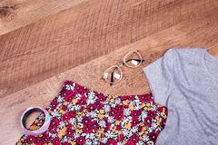 Skirt, T-shirt, glasses, place for text. Floral skirt, shirt and accessories stock images