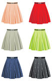 Skirts. Female skirts of different coloring on a white background Stock Images