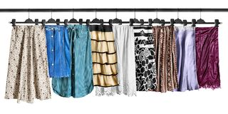 Skirts on clothes racks Stock Images