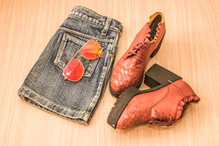 Skirts, jeans, leather shoes Royalty Free Stock Images