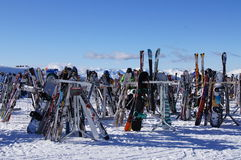 Skis and Boards. Racks full of skis, poles and snowboards on Whistler mountain, Canada. Feb 2012 Stock Photo
