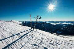 Skis are in deep snow on the ski track in sunny bright light Stock Images