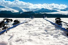 Skis and equipment on mountain slope in winter season Stock Photography