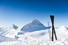 Skis in high mountains at sunny day Royalty Free Stock Photo