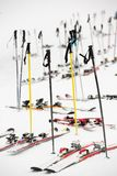 Skis parking, snowy winter scene, next to a ski slope. Winter sport symbol, skis and sticks without skiers, snowy ground Royalty Free Stock Photography