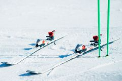 Skis and poles sticking out of the snow closeup. Nobody. Winter active sport concept. Mountain skiing equipment Royalty Free Stock Photos