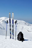 Skis, ski poles and backpack in Tatra mountains. A pair of skis, ski poles and a backpack in Tatra mountains in Poland Stock Photos