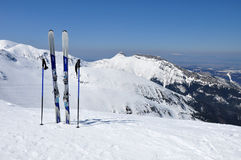 Skis, ski poles and Giewont in Tatra mountains Royalty Free Stock Photos
