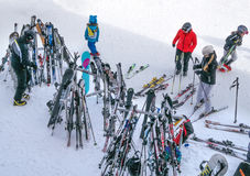 Skis and ski poles are standing front of a restaurant. Skiers went to dinner. Ski resort Royalty Free Stock Image