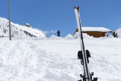 Skis in the snow with background blue sky and the ski slope Stock Images