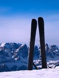 Skis in snow at mountains, nice sunny winter day at peak Royalty Free Stock Images
