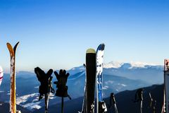 Skis in snow at Mountains. Skis with poles for active winter vacation in mountains. royalty free stock photo