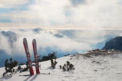 Skis in snow at mountains, very nice sunny winter day  at peak Stock Images