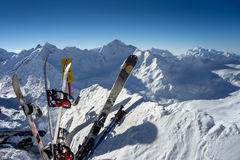 Skis and snowboards standing upright in snow Stock Images