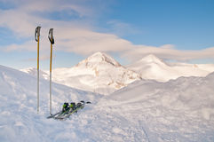 Skis and Snowy Peak Stock Image