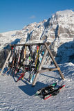Skis in a wood tool. Skis left out of a mountain restaurant at Pinzolo ski area in italian alps Stock Photo
