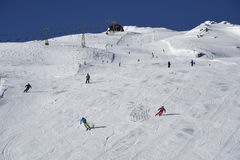 Skisloopes with alpine skiers Gaschurn. Skisloopes with alpine skiers at Madrisella. Gaschurn, Montafon valley, Austria, Europe Stock Image
