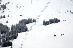 Skislope. With lift in the snowy mountains Royalty Free Stock Photos