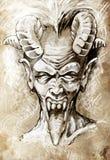 Skissa av tatueringkonst, jäkelhuvudet som är gotiskt Arkivfoto
