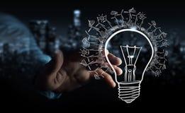 Skissar den rörande förnybara ecolightbulben för affärsmannen Arkivbilder