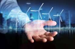 Skissar hållande förnybara energikällor för affärsmannen Arkivbild