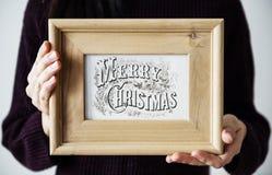 Skissar hållande jul för person ramen Arkivfoto