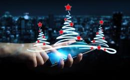 Skissar hållande julträd för affärsman över mobiltelefonen Fotografering för Bildbyråer