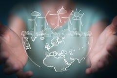 Skissar rörande och hållande förnybara energikällor för affärskvinnan Arkivbilder