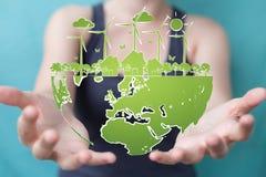 Skissar rörande och hållande förnybara energikällor för affärskvinnan Arkivbild