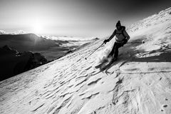Skitouring/freeriding in the mountains. Freerider enjoying the descent in high mountains during sunset Stock Images