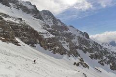 Skitouring. Woman skitouring in a breathtaking surroundings of high mountains. Italy, Julian Alps, Forca de la Val Royalty Free Stock Photos