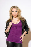 Skittish young blond woman Stock Photo