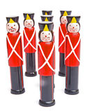 Skittles; childrens' game. Eight skittles in the form of a squad  of identical soldiers isolated against a bright background Royalty Free Stock Photo