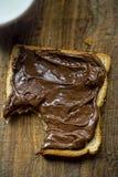 Skiva av bröd med nutella Royaltyfria Bilder