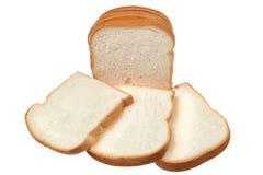 Skiva av bröd som isoleras på vit bakgrund Arkivfoto