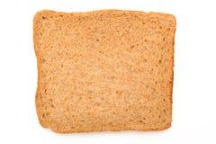 Skiva av brunt bröd Arkivbild